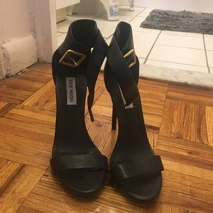 Black heels with ankle strap. Size 8.5